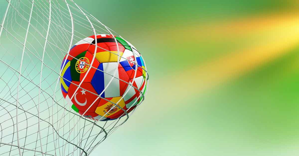 Soccer ball with flags from the world hitting net